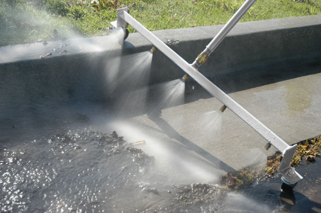 water broom cleaning gutter